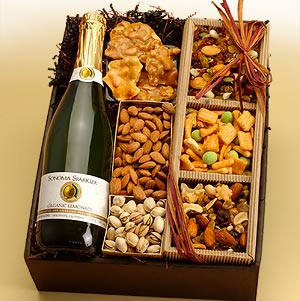 This gift basket includes roasted almonds, roasted pistachios, and honey peanut butter crunch.