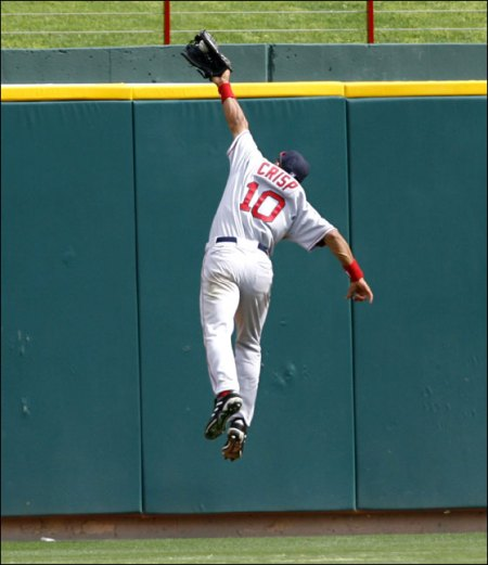 Coco Crisp leaps (almost!) over the wall.