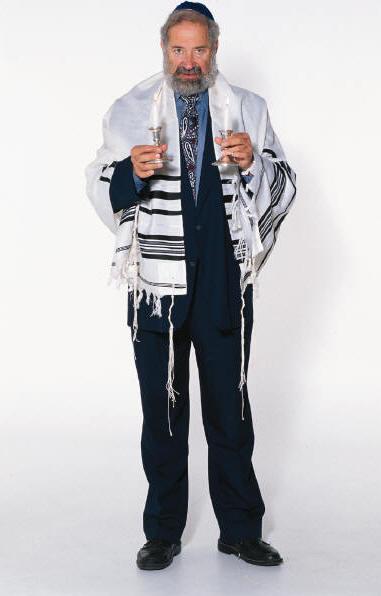 Jewish man wearing a prayer shawl with tassels at each corner.