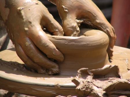 I64 potter's hands at work