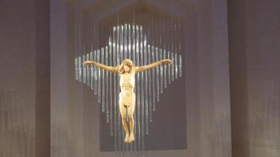 The crucifix at the front of the sanctuary is stunning, with a cross fashioned from hanging glass rods and a body carved from blond wood.