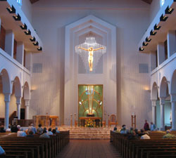 The crucifix at the front of the sanctuary is stunning, with a cross of hanging glass rods and a body carved from wood.